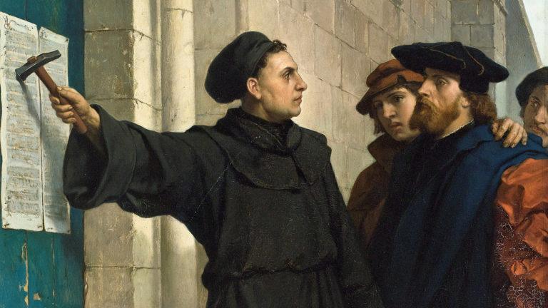 Лютер, прибивающий 95 тезисов в 1517. 1872